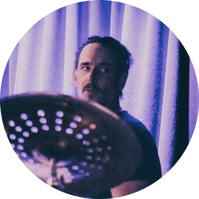 Damian Rodd playing the drums